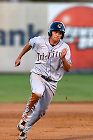 Michael Benjamin #15 of the Tri-City Dust Devils runs the bases during a game against the Salem-Keizer Volcanoes at Volcanoes Stadium on July 27, 2013 in Keizer, Oregon. Tri-City defeated Salem-Keizer, 5-4. (Larry Goren/Four Seam Images)