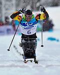 Lou Gibson, Vancouver 2010 - Para Nordic Skiing // Ski paranordique.<br /> Lou Gibson competes in Para Biathlon // Lou Gibson participe en parabiathlon. 13/03/2010.