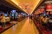 Las Vegas, Nevada.  The Linq Casino.  Gaming Tables on right, Slot Machines on left.