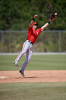 Washington Nationals Tyler Beckwith (7) jumps to catch a ball during practice before a minor league Spring Training game against the St. Louis Cardinals on March 27, 2017 at the Roger Dean Stadium Complex in Jupiter, Florida.  (Mike Janes/Four Seam Images)