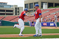 Buffalo Bisons center fielder Darrell Ceciliani (10) high fives manager Gary Allenson (5) while running the bases after hitting a home run during a game against the Syracuse Chiefs on July 31, 2016 at Coca-Cola Field in Buffalo, New York.  Buffalo defeated Syracuse 6-5.  (Mike Janes/Four Seam Images)