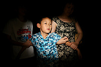CHINA. Beijing. A young boy near the Olympic village during the Beijing 2008 Summer Olympics. 2008