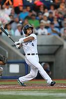 Gerard Hernandez (4) of the Hillsboro Hops bats during a game against the Salem-Keizer Volcanoes at Ron Tonkin Field on July 27, 2015 in Hillsboro, Oregon. Hillsboro defeated Salem-Keizer, 9-2. (Larry Goren/Four Seam Images)