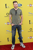 SANTA MONICA, CA, USA - NOVEMBER 16: Joel McHale arrives at the P.S. ARTS Express Yourself 2014 held at The Barker Hanger on November 16, 2014 in Santa Monica, California, United States. (Photo by Celebrity Monitor)
