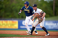 Canisius College Golden Griffins first baseman Ryan Stekl (15) holds base runner Carmen Benedetti (43) on during the second game of a doubleheader against the Michigan Wolverines on February 20, 2016 at Tradition Field in St. Lucie, Florida.  Michigan defeated Canisius 3-0.  (Mike Janes/Four Seam Images)