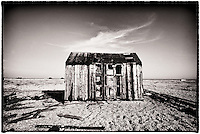 Wooden hut on the shingle beach at Dungeness, Kent, United Kingdom