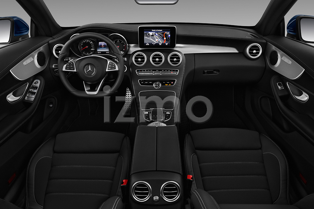 Stock photo of straight dashboard view of 2017 Mercedes Benz C-Class AMG-Line 2 Door convertible Dashboard