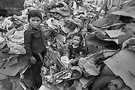 March 1979, Bogota, Colombia - Children sort recycled cardboard outside a garbage dump outside of Bogota. Child labor as seen around the world between 1979 and 1980 – Photographer Jean Pierre Laffont, touched by the suffering of child workers, chronicled their plight in 12 countries over the course of one year.  Laffont was awarded The World Press Award and Madeline Ross Award among many others for his work.