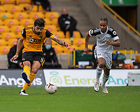 Wolverhampton Wanderers' Ruben Neves (left) crosses the despite the attentions of Fulham's Bobby Reid (right) <br /> <br /> Photographer David Horton/CameraSport<br /> <br /> The Premier League - Wolverhampton Wanderers v Fulham - Sunday 4th October 2020 - Molineux Stadium - Wolverhampton<br /> <br /> World Copyright © 2020 CameraSport. All rights reserved. 43 Linden Ave. Countesthorpe. Leicester. England. LE8 5PG - Tel: +44 (0) 116 277 4147 - admin@camerasport.com - www.camerasport.com