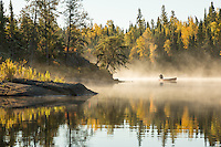 """""""Fall Treasures""""<br /> Surrounded by autumn's golden glow, a paddler pauses to take a photograph through the fog. The Boundary Waters Canoe Area Wilderness is one of the best treasures in Minnesota."""