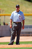 Third base umpire Mark Lollo during an International League game between the Norfolk Tides and the Charlotte Knights at Knights Stadium July 5, 2010, in Fort Mill, South Carolina.  Photo by Brian Westerholt / Four Seam Images