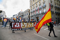 """MADRID, SPAIN - DECEMBER 07: A group of protesters march with Spanish flags and banners against illegal immigration on December 7 in Madrid, Spain. With the slogan """"frente a su imposición, nuestra voz"""" several groups of fascist ideology against illegal immigration that is reaching the coasts of the Canary Islands, have demonstrated in the center of Madrid to ask the government to end the illegal immigration and that migrants arriving on the Spanish coasts are not accepted. (Photo by Joan Amengual / VIEWpress)"""