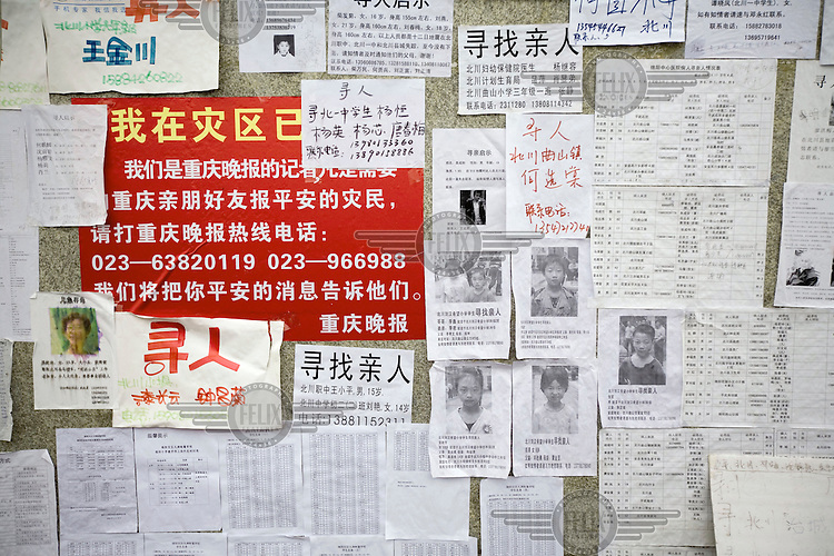 Missing persons notice board at Jiuzhou stadium where those who survived the earthquake put up their messages in search for their loved ones after the recent Sichuan earthquake of 12/05/2008, which measured 8.0 on the Richter scale. As the rescue effort goes on the death toll continues to rise, with five million people left homeless in Sichuan.