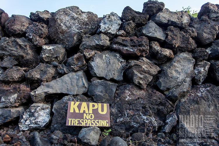 """""""Kapu"""" sign along a rock wall at Hikiau Heiau, Kealakekua Bay, Big Island."""