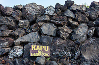 """Kapu"" sign along a rock wall at Hikiau Heiau, Kealakekua Bay, Big Island."
