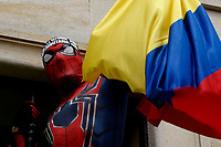 BOGOTA, COLOMBIA - MAY 01 : A man disguised as Spiderman holds a Colombian flag as people take part in a protest against government and the tax reform during the International Workers' Day on May 01, 2021 in Bogota, Colombia. Hundreds of Colombians protest against a tax bill reform plan for the fourth day in a row which aimed to raise some $ 6.3 billion in additional revenue over 10 years for Colombia, which saw GDP fall 6.8 percent in 2020 .(Photo by Leonardo Munoz/VIEWpress)