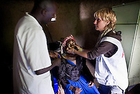 A woman is treated inside the Medecins Sans Frontieres (MSF) mobile clinic in the Kibati camp for displaced people. Thousands of people have been forced to leave their homes after renewed fighting in the region.