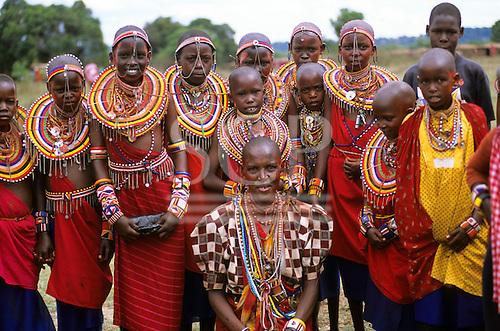 Lolgorian, Kenya. Siria Maasai Manyatta; group of girls with traditional bead neck adornments, keys, whistles, chains, belts.