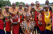 Lolgorian, Kenya. Siria Maasai Manyatta; group of girls with traditional bead neck adornments, keys, whistles, chains, belts.