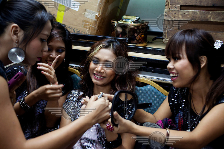 Member of 'Me N Ma Girls', Myanmar's first girl band, laugh and joke together before a performance at a private function in a hotel in Yangon. The band's members were recruited by Australian dancer Nicole May. They sing and dance in the manner of many Western pop acts but in socially conservative Myanmar, they represent a radical break from the norm.