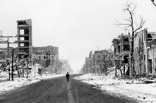 Grozny, Chechyna.January 1995.The city center is completely destroyed and looks vey much like Berlin after WWII. This man was walking through a no-mans-land without realizing that both Russian and Chechen snipers occupied the buildings around him.