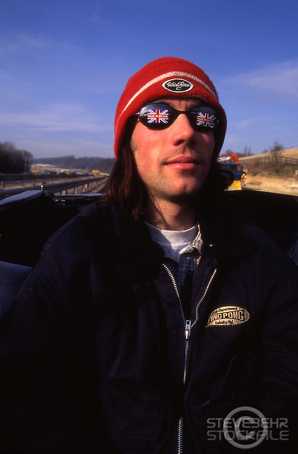 Rob Warner in back seat of Mustang on Motorway <br /> pic copyright Steve Behr / Stockfile