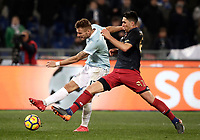 Calcio, Serie A: Lazio - Genoa, Roma, Stadio Olimpico, 5 Febbraio 2018. <br /> Lazio's Ciro Immobile (l) in action with Genoa's Ervin Zukanovic (r) during the Italian Serie A football match between Lazio and Genoa at Rome's Stadio Olimpico, February 5, 2018.<br /> UPDATE IMAGES PRESS/Isabella Bonotto