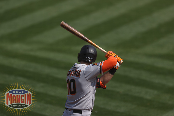 OAKLAND, CA - SEPTEMBER 20:  Evan Longoria #10 of the San Francisco Giants bats against the Oakland Athletics during the game at the Oakland Coliseum on Sunday, September 20, 2020 in Oakland, California. (Photo by Brad Mangin)