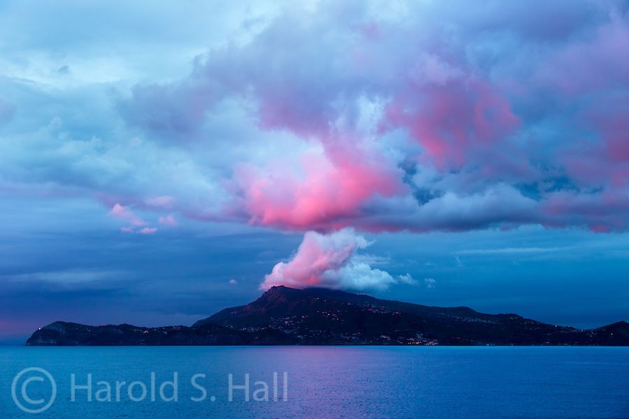 The sunset on the clouds above the mountains of Sicily, Italy glow like the famous volcanoes ealy.lsewhere in It