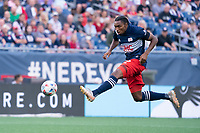 FOXBOROUGH, MA - JULY 25: Jon Bell #22 of New England Revolution during a game between CF Montreal and New England Revolution at Gillette Stadium on July 25, 2021 in Foxborough, Massachusetts.