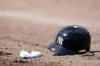 New York Yankees outfielder Chris Dickerson helmet laying on the warning track before a scrimmage against the USF Bulls at Steinbrenner Field on March 2, 2012 in Tampa, Florida.  New York defeated South Florida 11-0.  (Mike Janes/Four Seam Images)