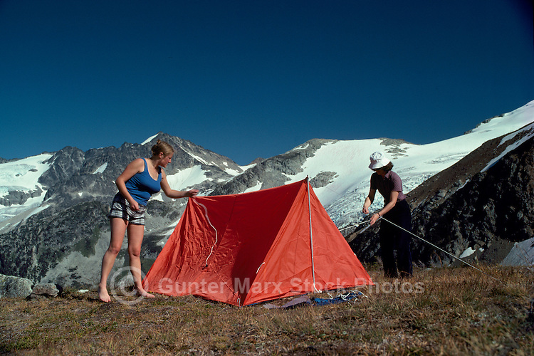 "Hikers pitching Tent at ""Singing Pass"" in Garibaldi Provincial Park, near Whistler, BC, British Columbia, Canada"