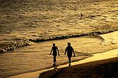 Salvador, Bahia, Brazil. Walking on Rio Vermelho in a coppery dusk.