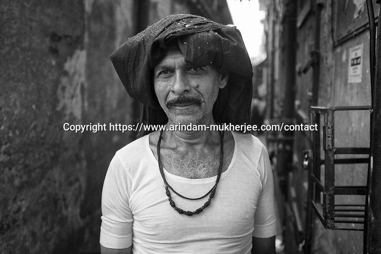 Durga Das (47) is a daily wage laborer, who migrated to Kolkata from Bihar for better fortune. He earns about 4 USD perday. Kolkata, India.