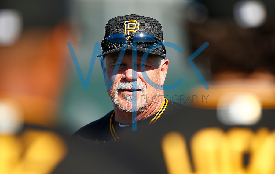 Pitching coach Ray Searage of the Pittsburgh Pirates leads the team before breaking off into groups for their workouts during spring training at Pirate City in Bradenton, Florida on February 19, 2016. (Photo by Jared Wickerham / DKPS)