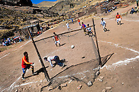 Indigenous men play football on a dirt football pitch in the rural mountain community close to Puno, Peru, 6 August 2012. Football, the most popular sport in Latin America, is widely played even in the remote and sparsely populated places in the mountains and jungles. The 2014 FIFA World Cup in Brazil is the most eagerly anticipated sporting event for all Latin Americans.