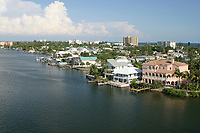 Residential homes,highrise condos and businesses line the coastline of Fort Myers Beach and the Caloosahatchee River,Florida. Gulf of Mexico.