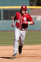 Matt Oberste #14 of the Oklahoma Sooners runs the bases during a game against the UCLA Bruins at Jackie Robinson Stadium on March 9, 2013 in Los Angeles, California. (Larry Goren/Four Seam Images)