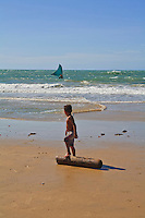 A child sees his father going fishing in Nordeste sea Brazil