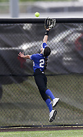 Rogers outfielder Ava Johnson (20) reaches for a homerun, Thursday, April 29, 2021 during a softball game at Bentonville High School in Bentonville. Check out nwaonline.com/210430Daily/ for today's photo gallery. <br /> (NWA Democrat-Gazette/Charlie Kaijo)