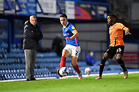 Callum Johnson of Portsmouth plays a pass under pressure from Olamide Shodipo of Oxford United during Portsmouth vs Oxford United, Sky Bet EFL League 1 Football at Fratton Park on 24th November 2020