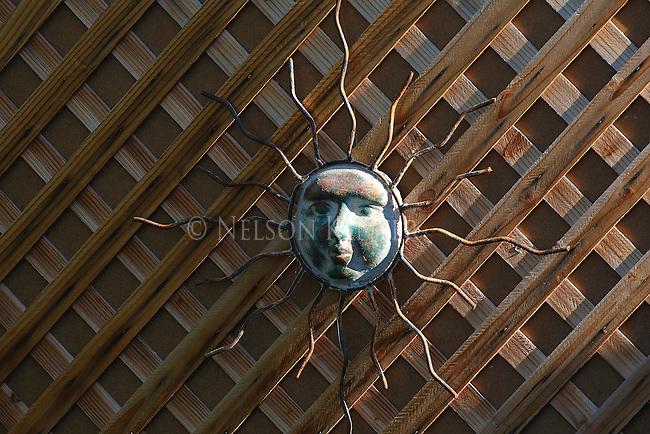Sun face decoration on lattice panels