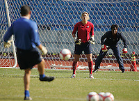 USWNT goalkeeper coach Phil Wheddon serves the ball into goalkeepers Hope Solo (left) and Briana Scurry (right) during practice for the Queen Peace Cup at Olympic Stadium in Seoul, South Korea, October 27, 2006.