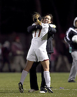 """Boston College defender Hannah Cerrone (11) celebrates her goal/victory with Boston College head coach, Alison Foley. In overtime, Boston College defeated University of Washington, 1-0, in NCAA tournament """"Elite 8"""" match at Newton Soccer Field, Newton, MA, on November 27, 2010."""