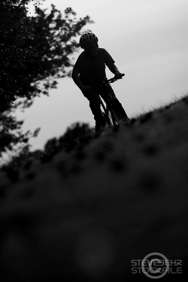 Josh  mountain biking silhouette.wentworth, surrey  june 2010.