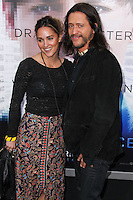 """WESTWOOD, LOS ANGELES, CA, USA - APRIL 10: Megan Ozurovich, Clifton Collins Jr. at the Los Angeles Premiere Of Warner Bros. Pictures And Alcon Entertainment's """"Transcendence"""" held at Regency Village Theatre on April 10, 2014 in Westwood, Los Angeles, California, United States. (Photo by Xavier Collin/Celebrity Monitor)"""