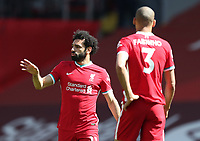24th April 2021; Anfield, Liverpool, Merseyside, England; English Premier League Football, Liverpool versus Newcastle United; Mohammed Salah of Liverpool speaks with team mate Fabinho of Liverpool