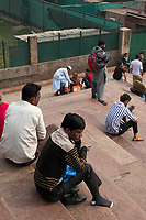 People gather on the steps of Jama Masjid in the Chadni Chowk area of Delhi, India, on Tue., Dec. 11, 2018. Jama Masjid is also known as Masjid-i Jehan Numa; it is one of the largest mosques in India, built between 1650 and 1656.