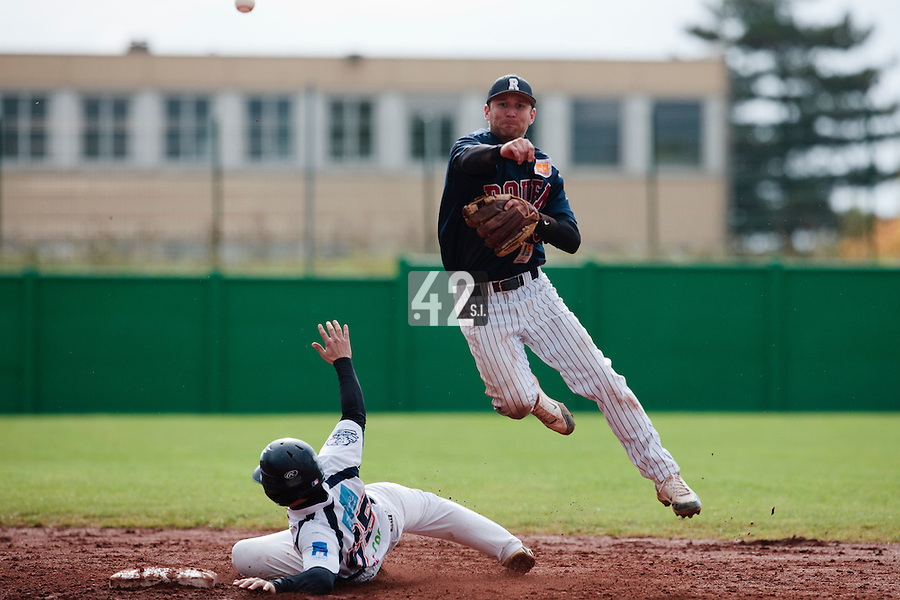 16 October 2010: Aaron Hornostaj of Rouen throws the ball to first base for a double play during Rouen 16-4 win over Savigny, during game 1 of the French championship finals, in Savigny sur Orge, France.