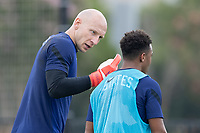 FRISCO, TX - JULY 20: Brad Guzan speaks to Jonathan Lewis during training during a training session at Toyota Soccer Center FC Dallas on July 20, 2021 in Frisco, Texas.